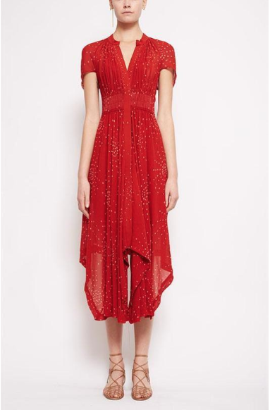This festive red  Galaxy smock waist dress  ($695) is made from 100% silk and is printed with a constellation of intricate bandhani dots (a tie-dye process perfected by hand). With an asymmetrical hemline that rises at the rear, capped sleeves beautifully rouched across the shoulders and an elasticised belt exposed at the back of the waist, it's perfect for a luncheon or an evening soirée (simply pull your hair up loosely, dangle a long statement eating in one lobe and add a dash of scarlet lippy).