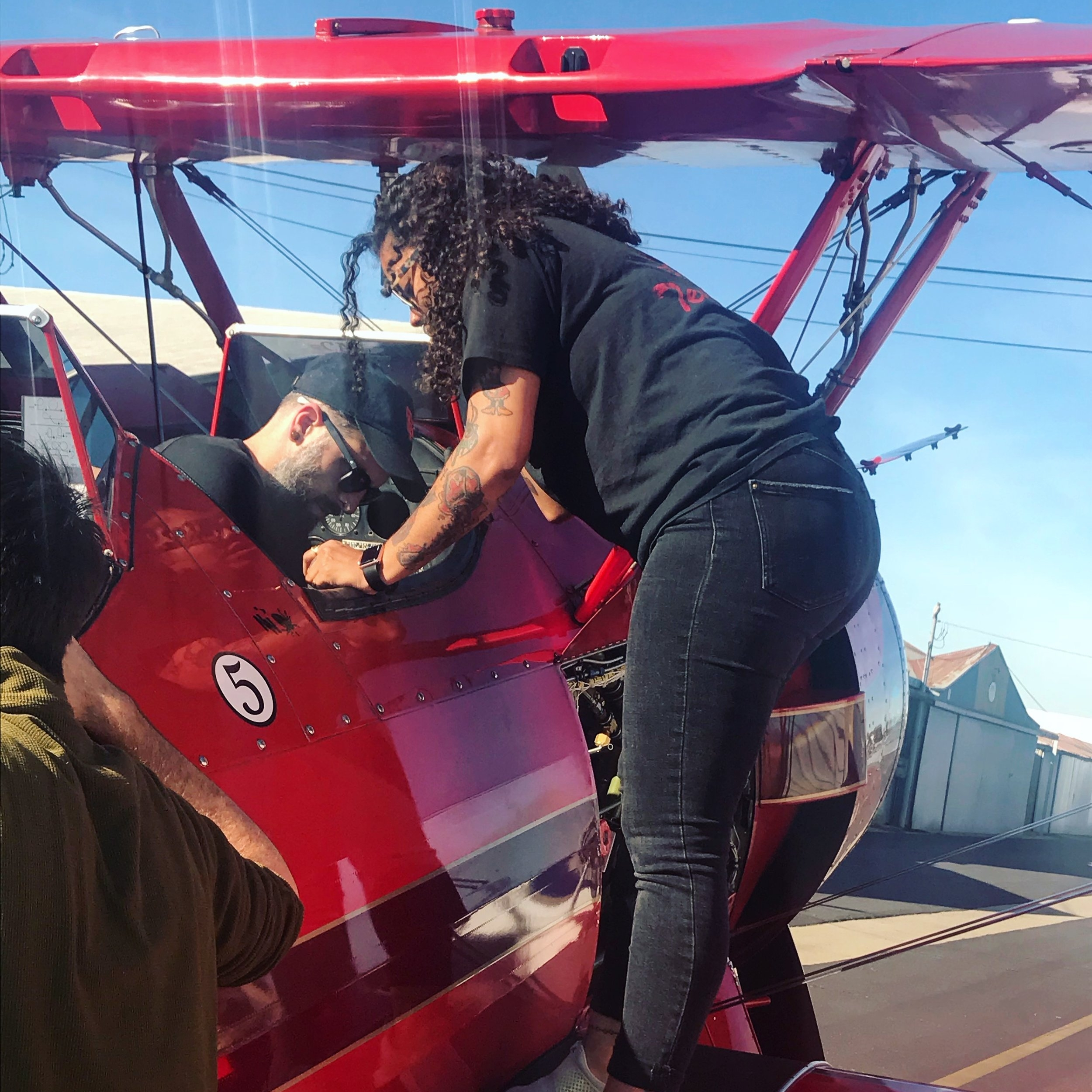 Rigging mics on a biplane before takeoff