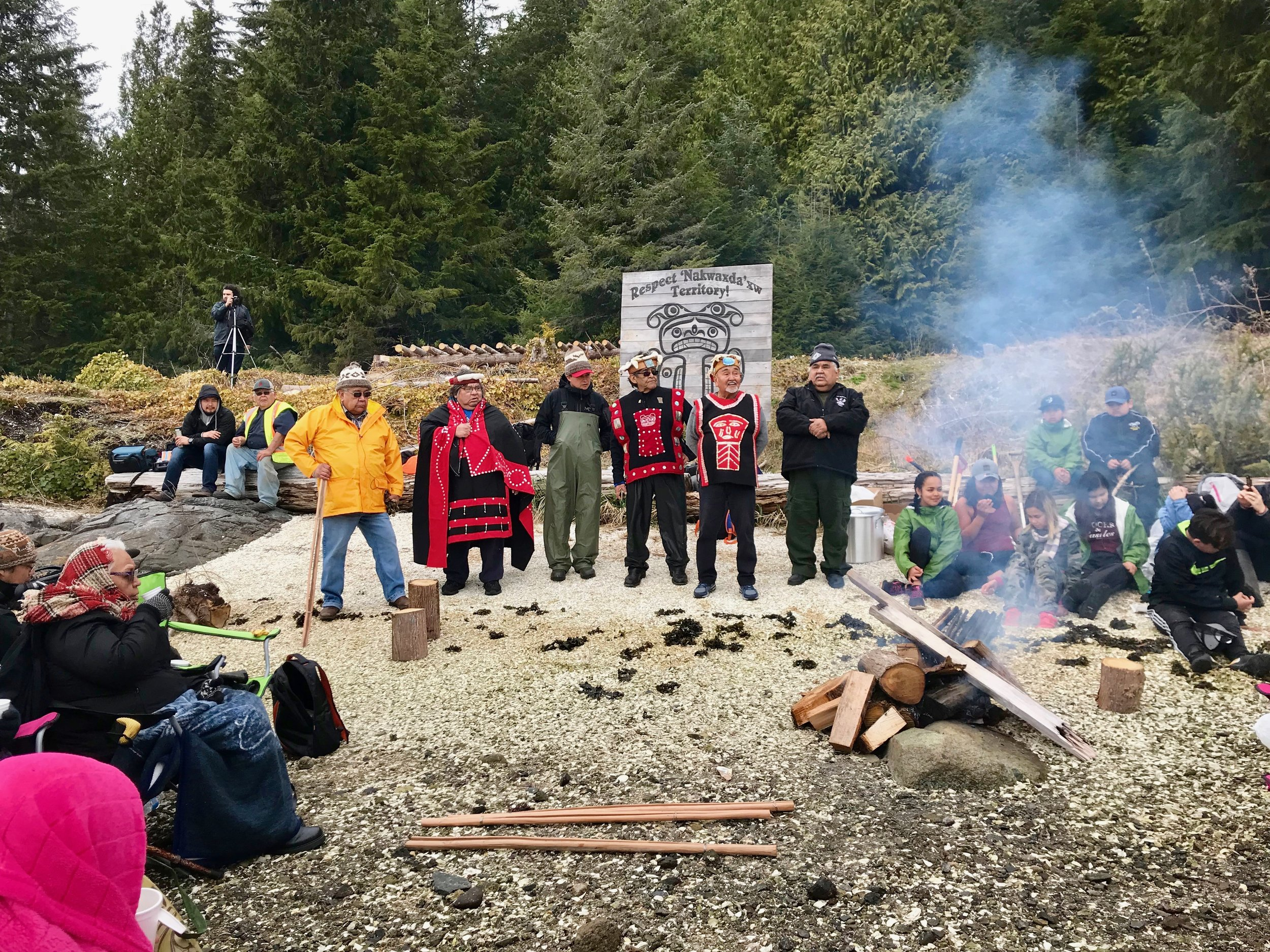 Hereditary chiefs conducting welcome ceremony for elders and youth visiting the traditional homeland of the 'Nakwaxda'xw, April 2018