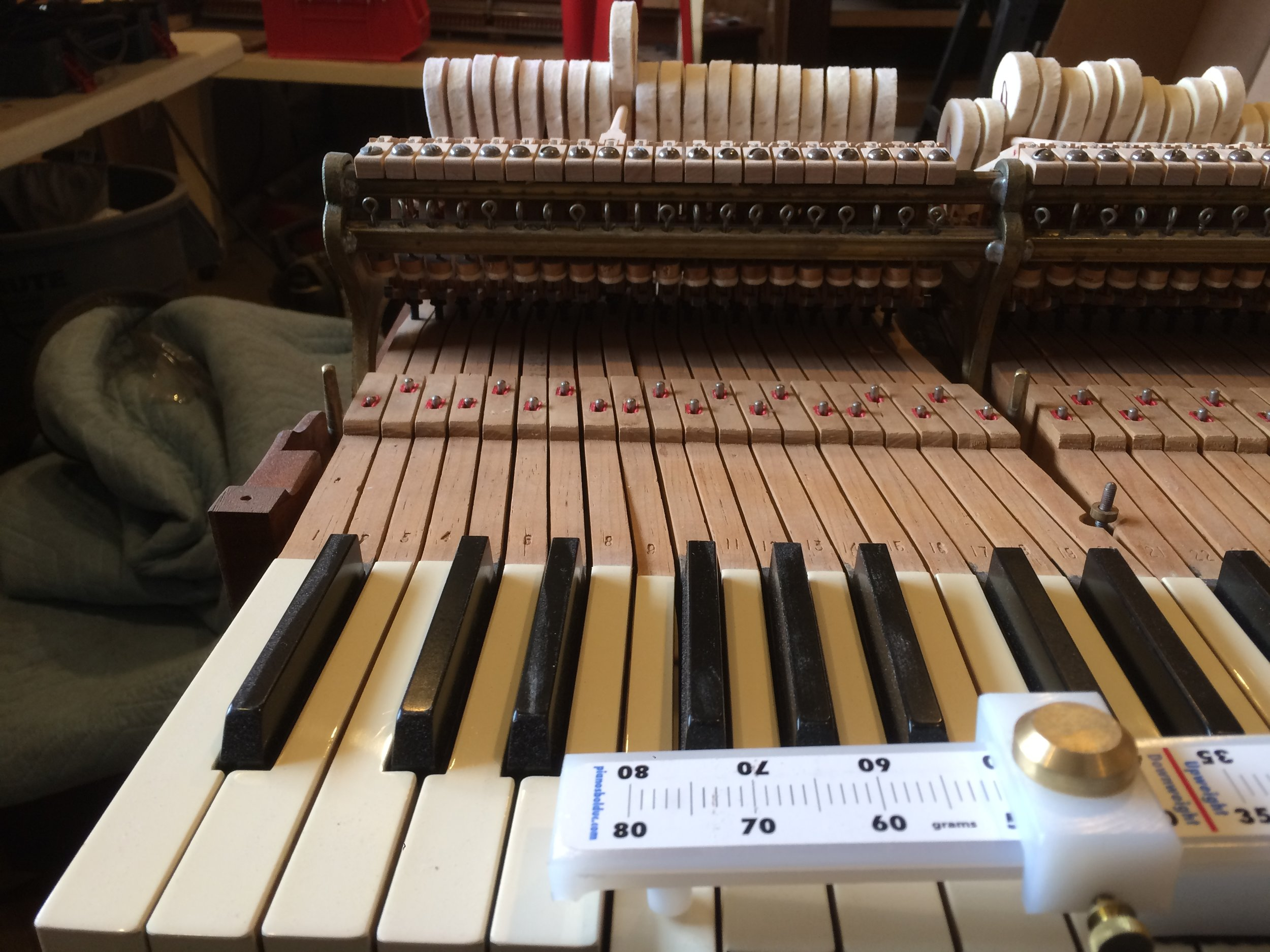 Calibrating the touchweight for a Steinway grand piano.