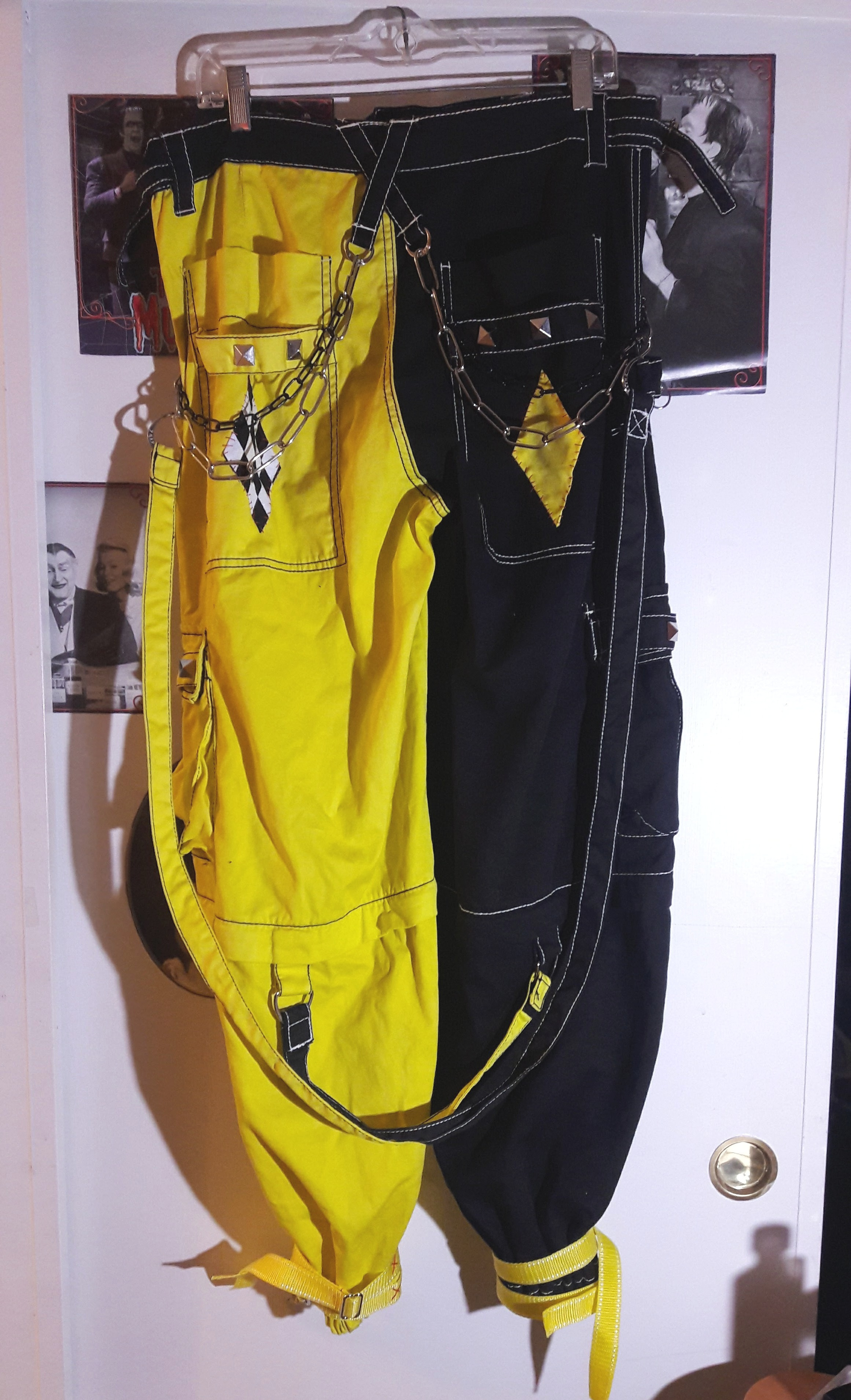 Tweak- Fright Fest, 2016  Piece commissioned by Cole Potter  Trip pants purchased and customized: Dyed yellow, elastic added to hem, straps , chains, studs, & patches added.