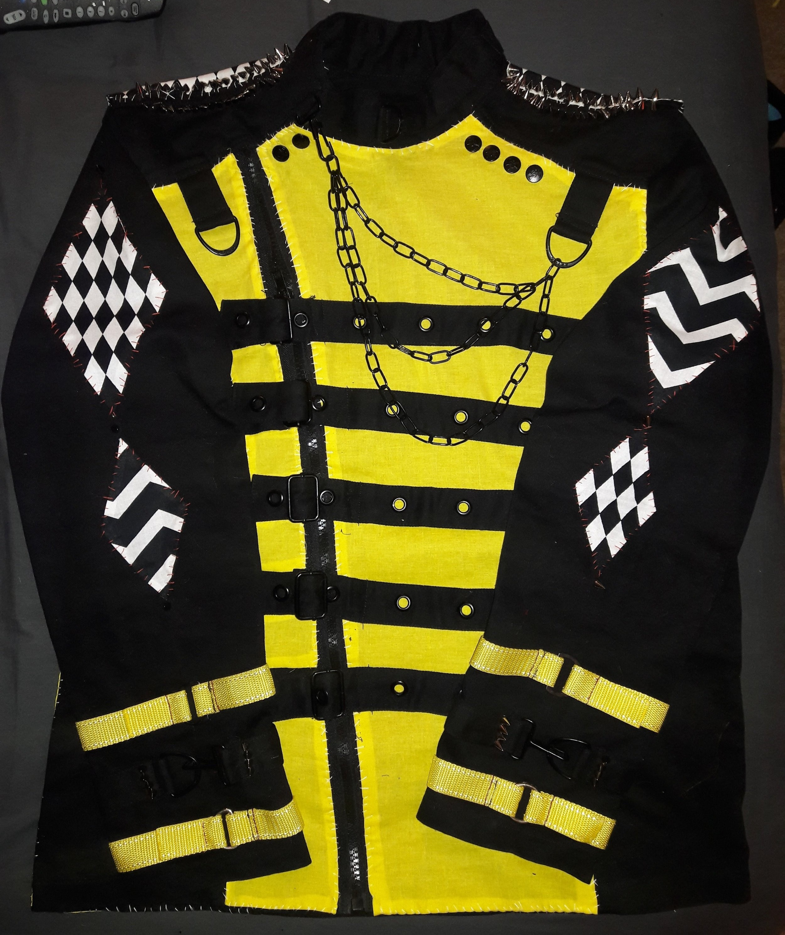Tweak- Fright Fest, 2016  Piece commissioned by Cole Potter  Trip jacket purchased and customized: yellow paneling added, studs, patches, straps, and chains added.