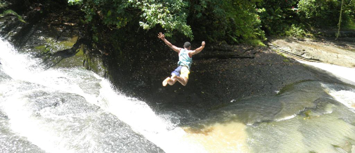 mark-in-fiji-one-of-the-local-boys-diving-into-a-waterfall-pool.jpg
