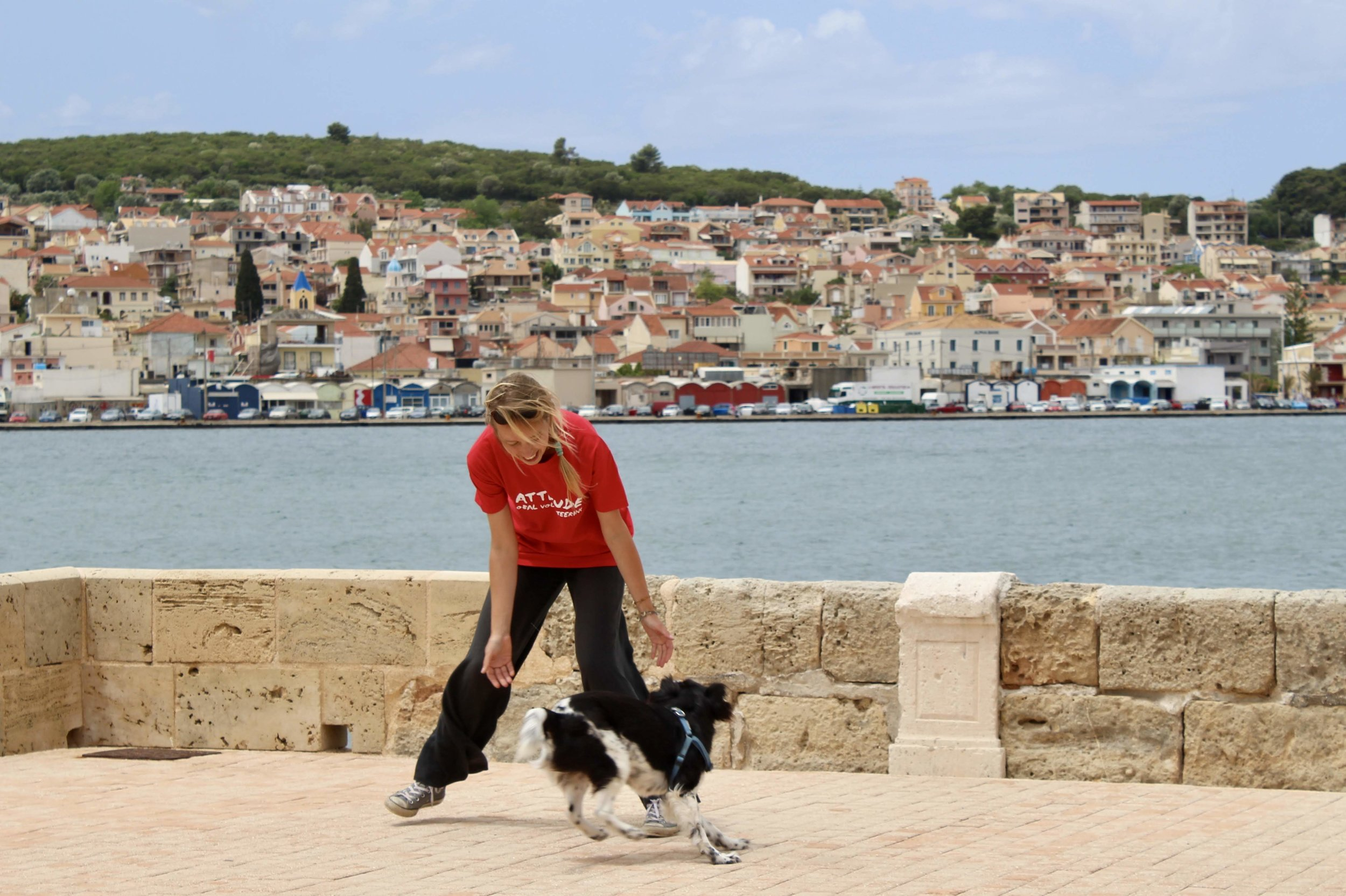evelin plays with dog in greece.JPG