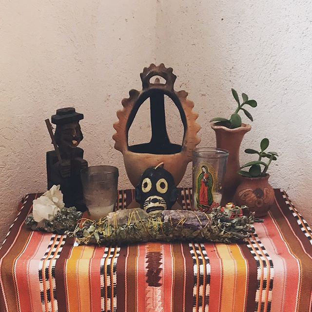 We're off to Costa Rica!  Here's the altered version of my alter left for the renters of our place in San Marcos while we travel. Removing my personal items this one is protecting our space with folk art from Guatemala, mica and quartz crystal, sacred herbs and stones from my friends in california @goddessfeathers and @hey_ester all on a beautiful handwoven, vintage cargadora.  #guatemalantextiles #altar #sanmarcoslalaguna #religioussyncretism #batz #sansimeon #maximon #virgindeguadelupe