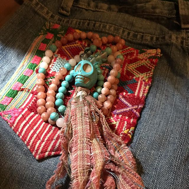 Mala from healing stones and upcycled Guatemalan textile tassels. I brought enough beads to Costa Rica to make a handful of these prayer beads and they're almost sold out.  Upcycled Jean shorts bedazzled with Mayan huipil from Huehuetenango . . . #upcycled #guatemalantextiles #malabeads #prayerbeads #sacredstones #turquoise #caldera