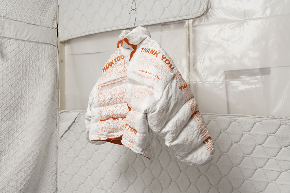 """Take Out Jacket  at the   WastedLA Pop-Up. """"40 plastic take out bags lined with silk scraps and stuffed with feathers taken from a discarded down comforter."""""""