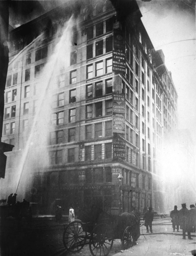 The Triangle Shirtwaist Factory, a 10-story building in New York, being hosed down on March 25, 1911 where 146 workers lost their lives in one the country's worst workplace tragedies. (Source:  Cornell / Wikipedia )