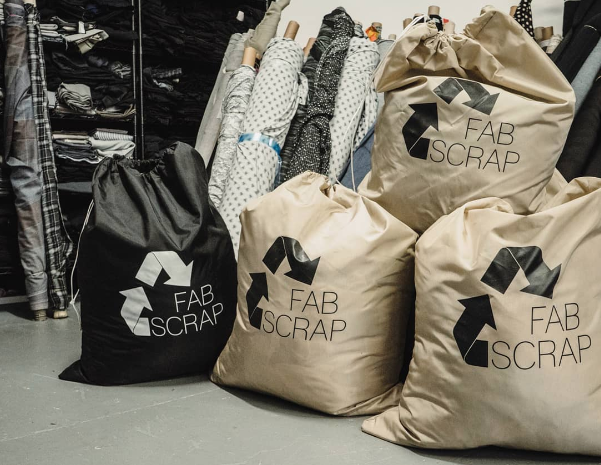 """""""When a fashion, interior design, or costume company signs up for our recycling service we send them bags to collect their unwanted fabric. Black bags are for any proprietary materials (things with logos or trademarked patterns), which will only be recycled. Brown bags are for everything else, and most importantly - the material inside can be reused. Everything we have in the Reuse Room at our warehouse, in our online store, or at pop-up sales comes from brown bags. Last year brown bags received outnumbered black bags 5:1!"""" ( @fabscrap Instagram )"""