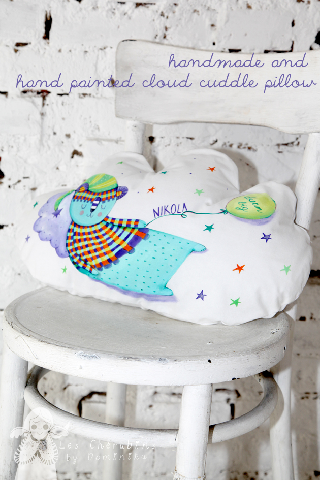 handmade and hand painted cloud cuddle pillow 51x32cm by Dominika Bozic photo was taken in Cvjetna galerija RL in Zagreb, Croatia