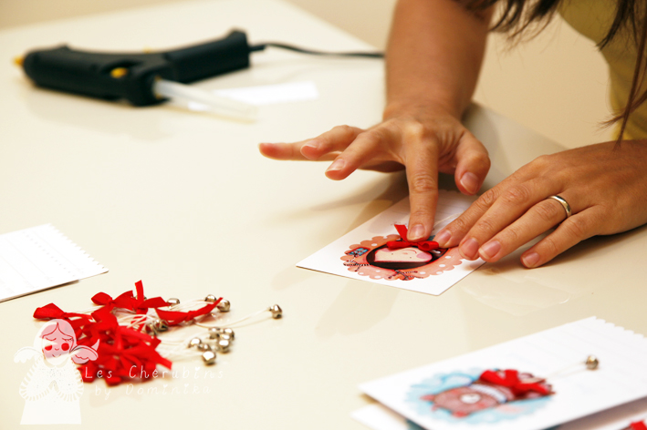 attaching the bows with the glue gun