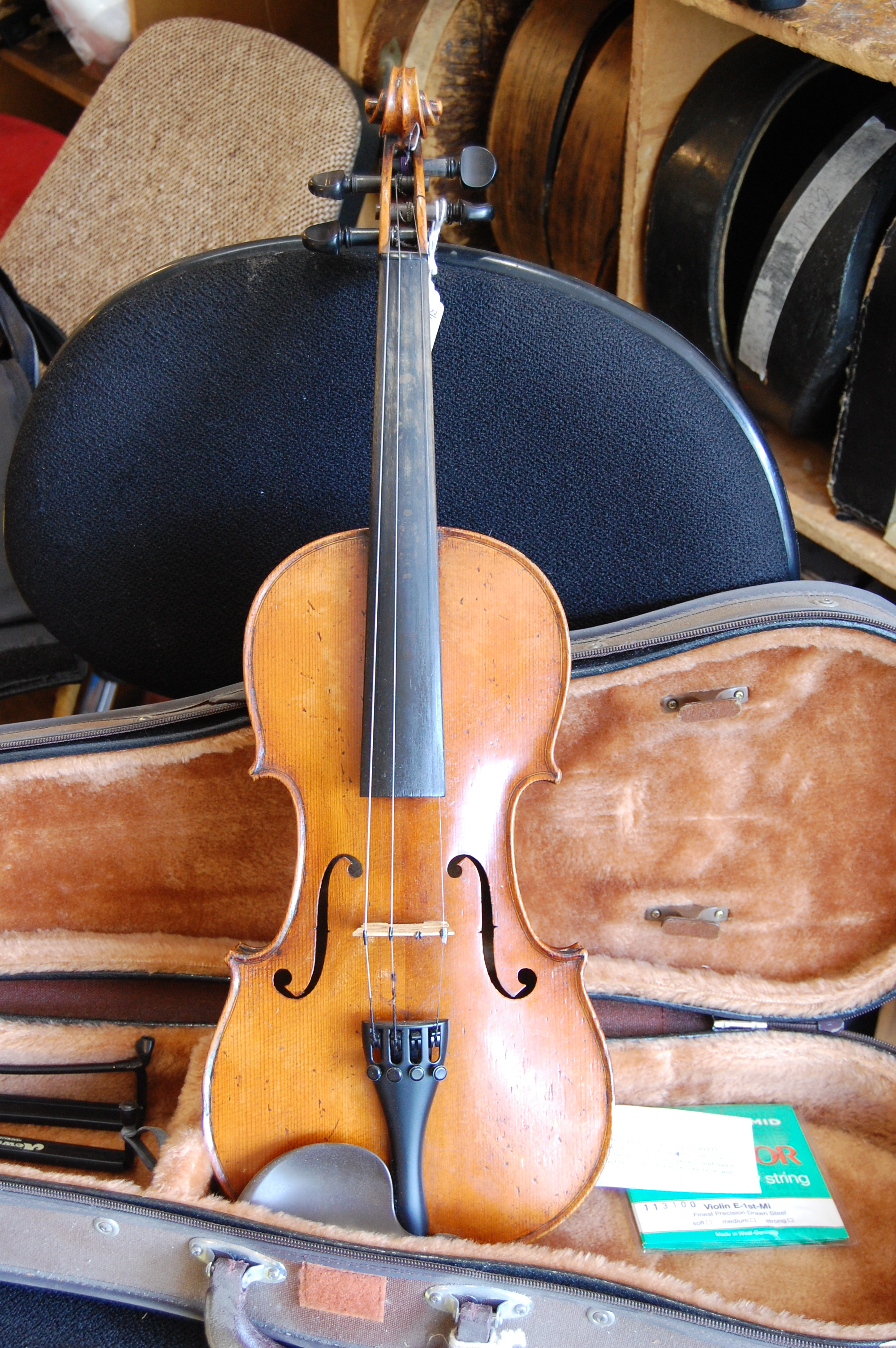 3/4 size German violin from 'Mittenwald' C1870. Comes with shaped case, price £500 CS005  Condition: Reasonable  Tone: 3/5  Value for money: 4/5  Overall rating: 3/5