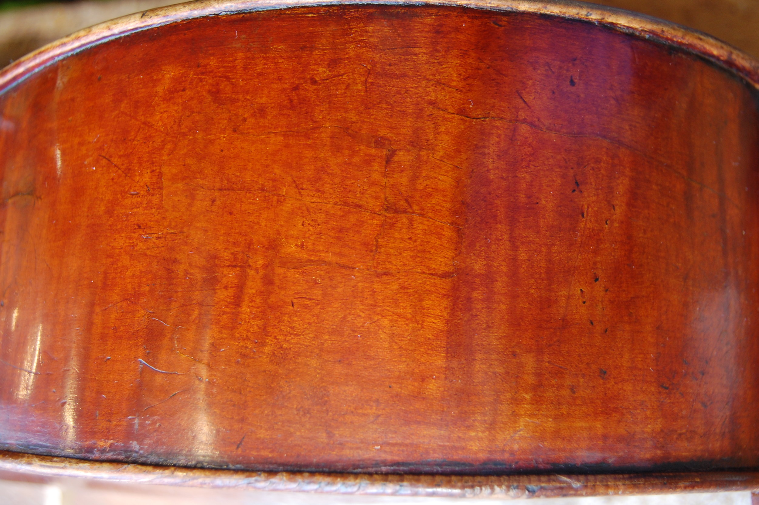 After!  The benefits of hide glue over synthetic are as follows;  It dries transparent so if you are gluing a crack there's no visible line or on any joint,  It's water soluble so that if a joint needs to come apart the old glue can be washed away back to bare wood ready for re- gluing,  The glue remains stable through time, there's no 'creep' or movement as there would be with a PVA type synthetic glue.