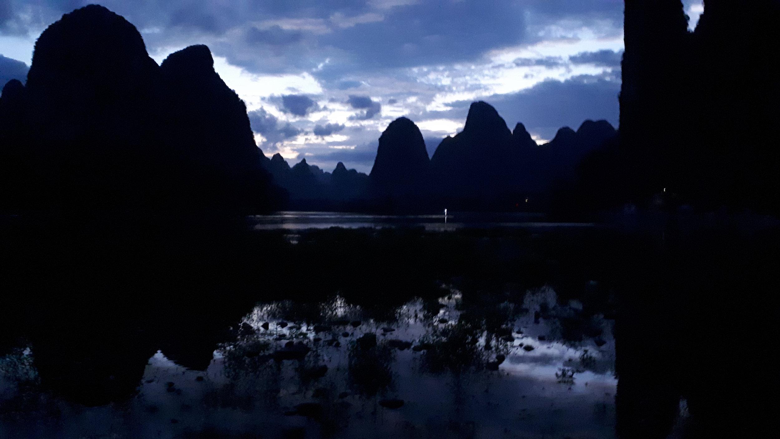 Blue hour light silhouetting the karst limestone mountains