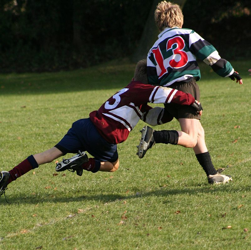 Schoolkids_doing_a_rugby_tackle.jpg