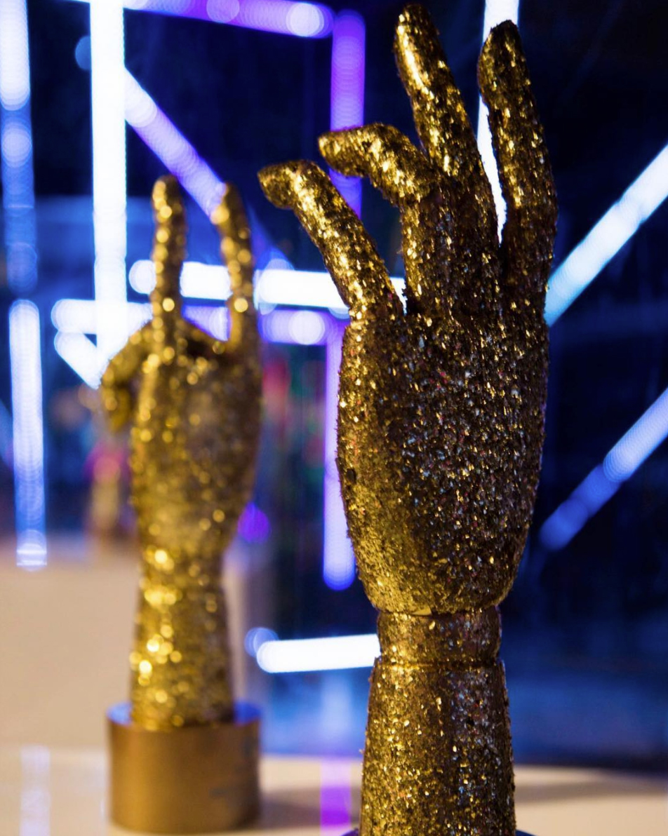 HAND TROPHIES - Inspired by the photoshoot, hand awards were created for the ceremony.