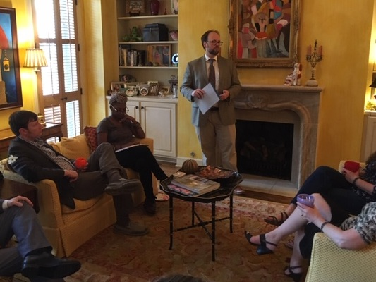 Future901's cofounder, Robert Donati (standing), shares Future901's vision for 2020 at a fundraiser