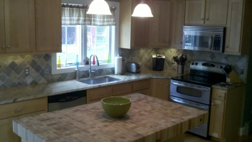 Countertop Ugrade from Laminate to Magelano Granite - Butcher Block Island Top done by others