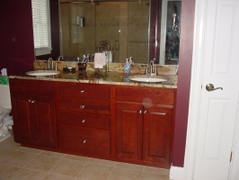 Aristokraft - Saybrook door style - Birch wood - Rouge stain - Rainforest Green granite vanity top