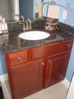 Aristokraft - Saybrook door style - Birch wood - Rouge stain - Palette Blue Butterfly vanity top