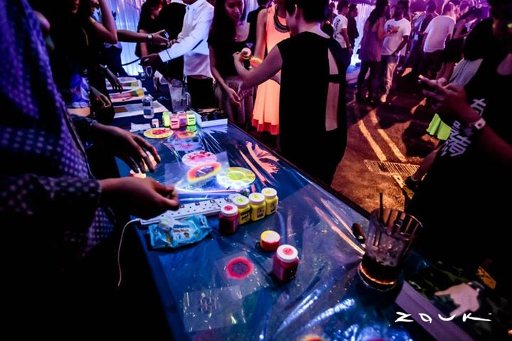 A UV paint tattoo booth was set up and the same custom-made designs were used as UV decorations that lined the interior of the club for the event.