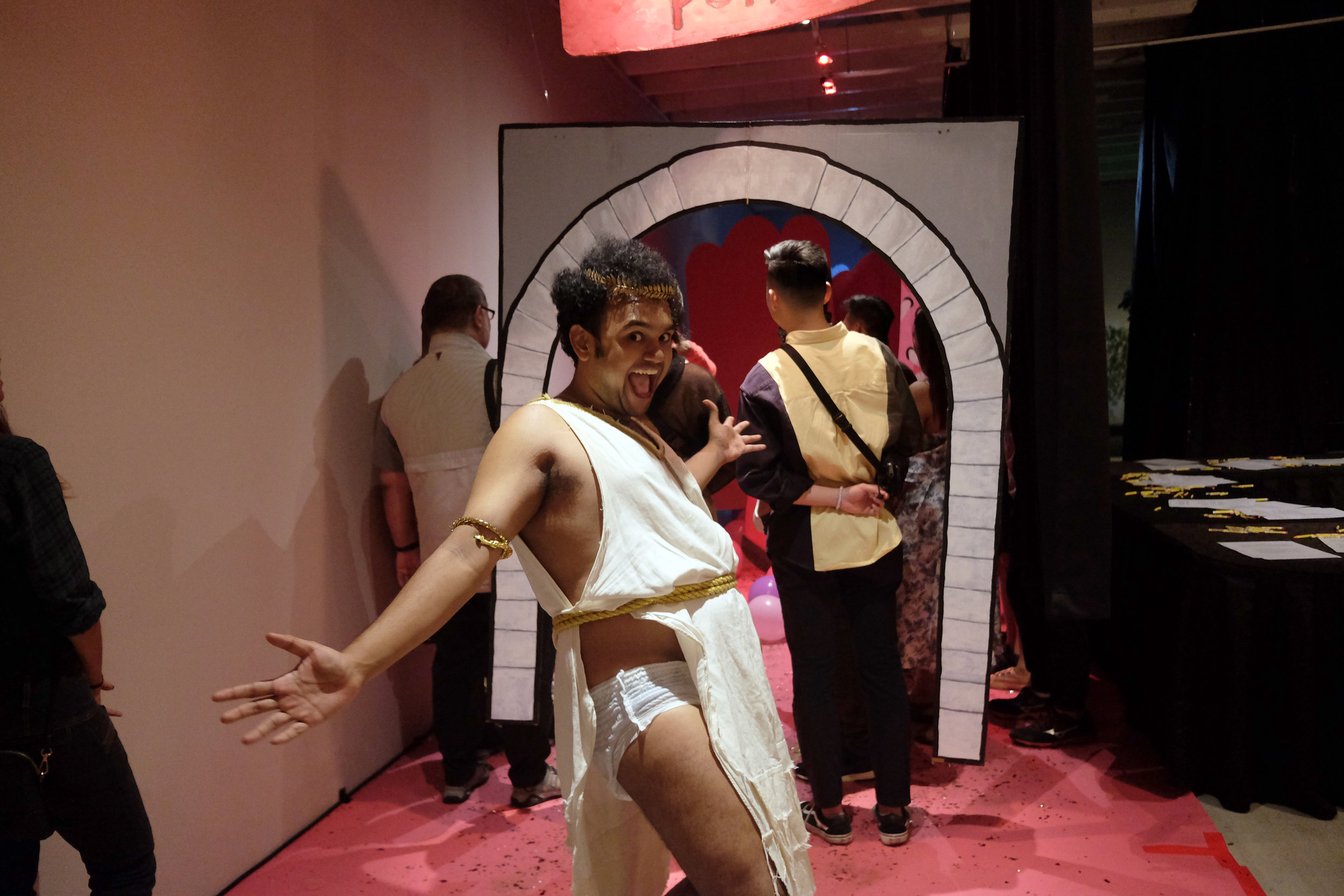 An actor standing in front of an archway, as part of Patch and Punnet's interactive theatre experience, 'Cupid's Theatre'.