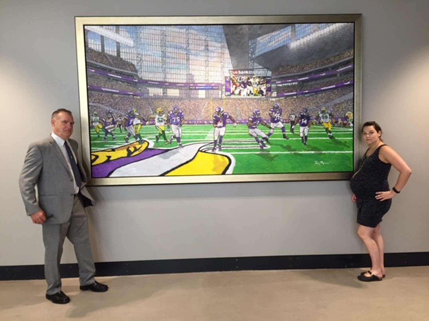 Large canvas by Tom Mosser that we stretched and framed for US Bank Stadium.