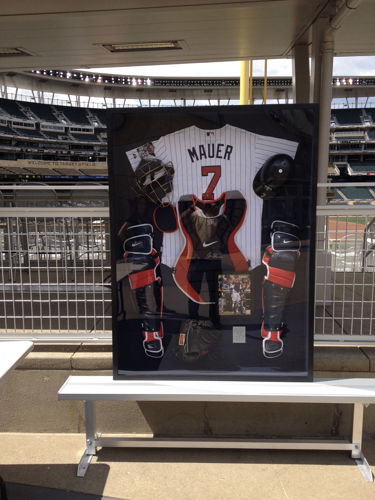 A shadowbox that we created to fit Joe Mauer's catcher uniform. We had to custom mill a frame to fit the depth of all the equipment.  The shadowbox was auctioned off at the All Star Game at Target Field.