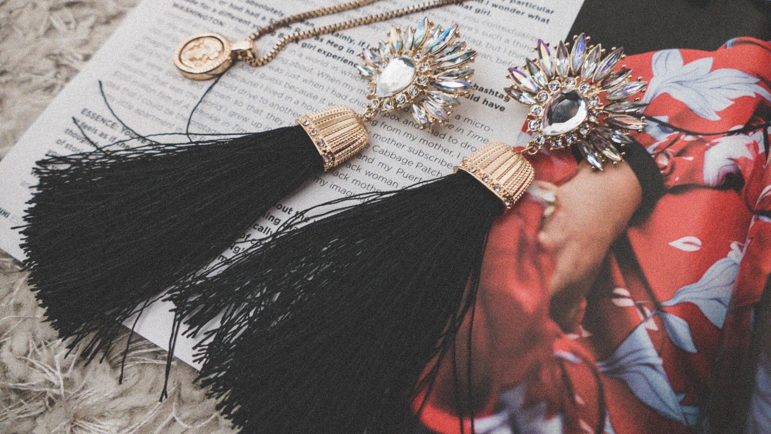 Tassel earrings stacked rings, rose gold watch, accessories