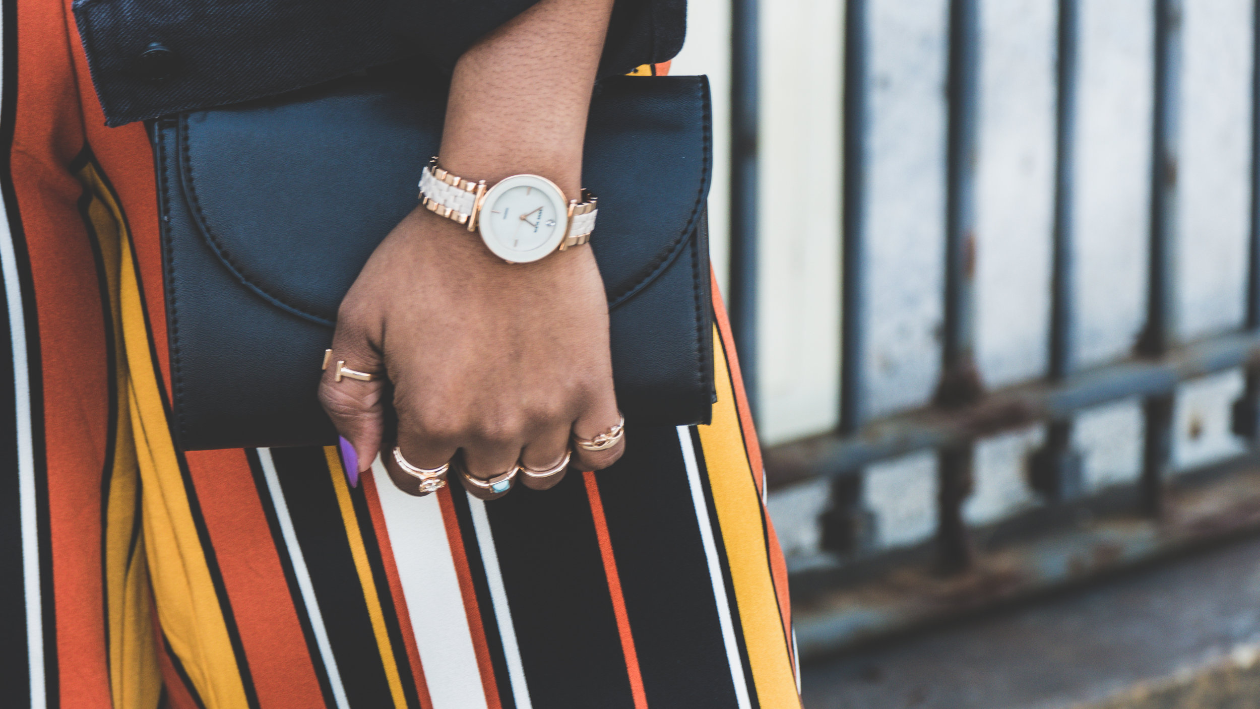 stripe trousers outfit, anne klein watch, graphic tee, oversized denim jacket