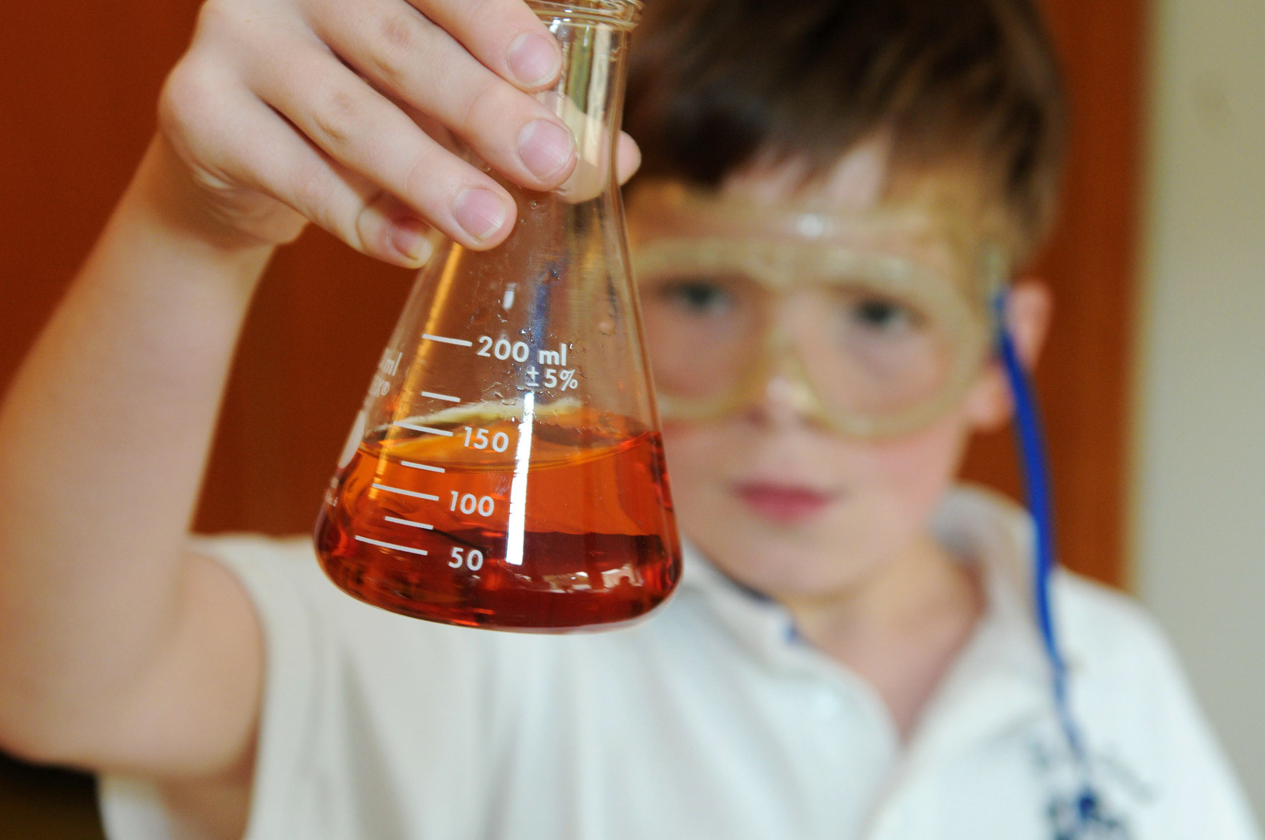 Maura Wayman Photography, Photography, Corporate Photography, stock, stock images, Massachusetts, Boston, Metro West, Wellesley, close up, children,  private school, parochial school, uniforms,  boy, classroom, beaker, science, protective glasses,