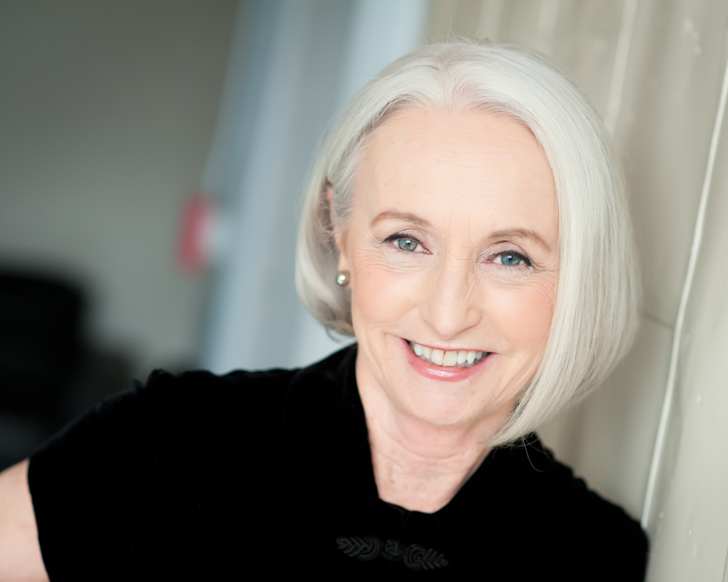 Headshot of older woman with silver hair