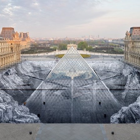The street artist, JR's trompe l'oeil installation now on view at the Louvre in Paris •  #onview #installation #streetart #paris #louvre #publicart #museum #30thanniversary #pyramids #anniversaryinstallation #opticalillusion
