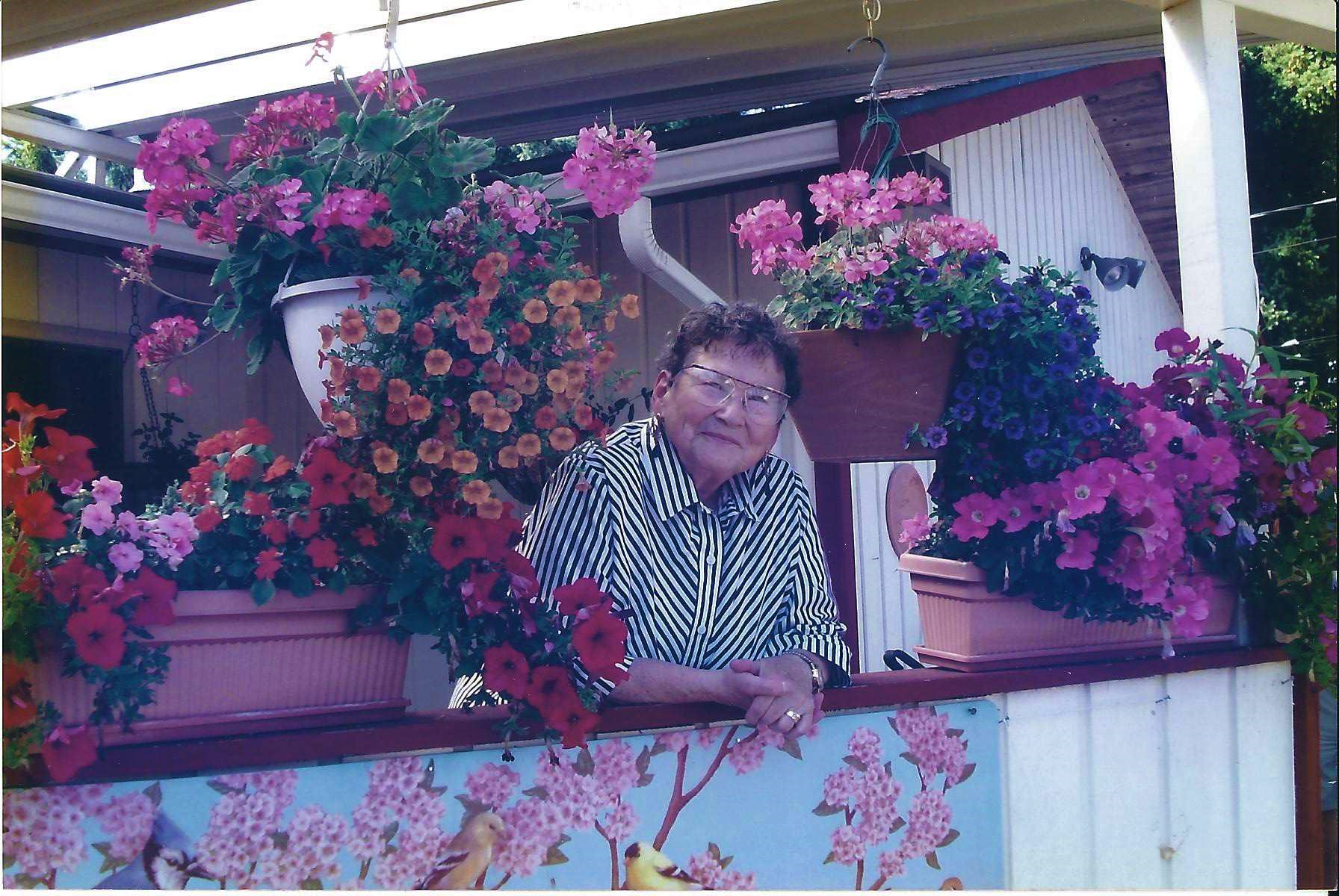 Ginny with Porch flowers.jpg