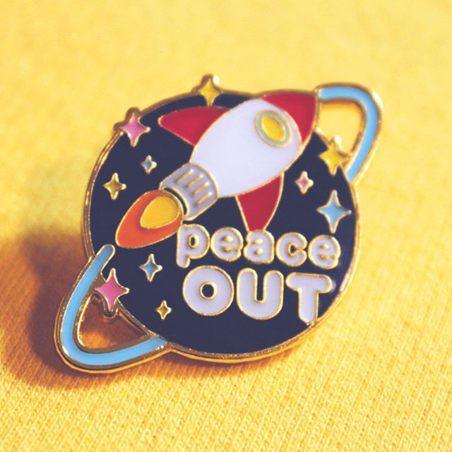 PEACE OUT 🚀⭐️✌️ my very first original enamel pins have launched!! ✨✨ [ available in my store : link in bio ] . . . . #enamelpins #enamelpin #design #illustration #typography #designinspiration #graphicdesign #pin #spaceaesthetic #rocket #space #stars #sparkles