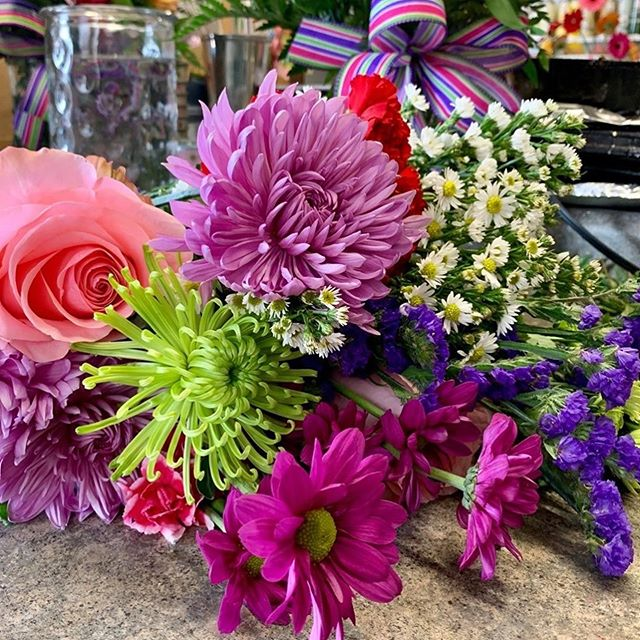 Our cooler is full and our designers are hard at work on our Mother's Day bouquets!