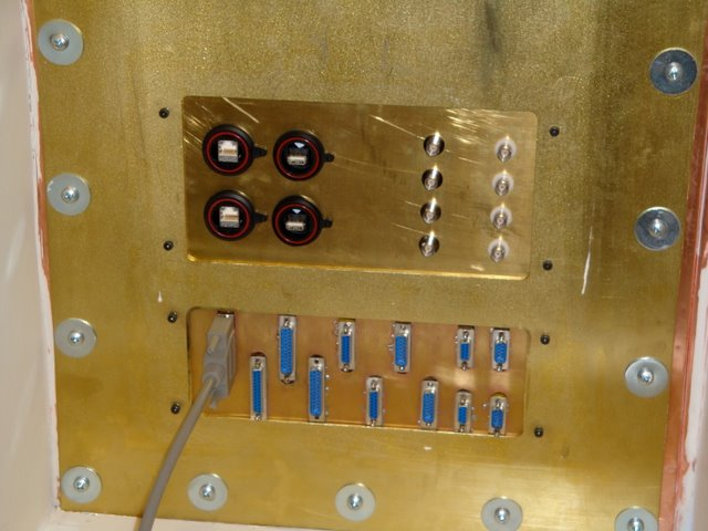 Buckner Lab/MRI facility: Patch panel maintains shielding while allowing cabling to reach into the scan area.