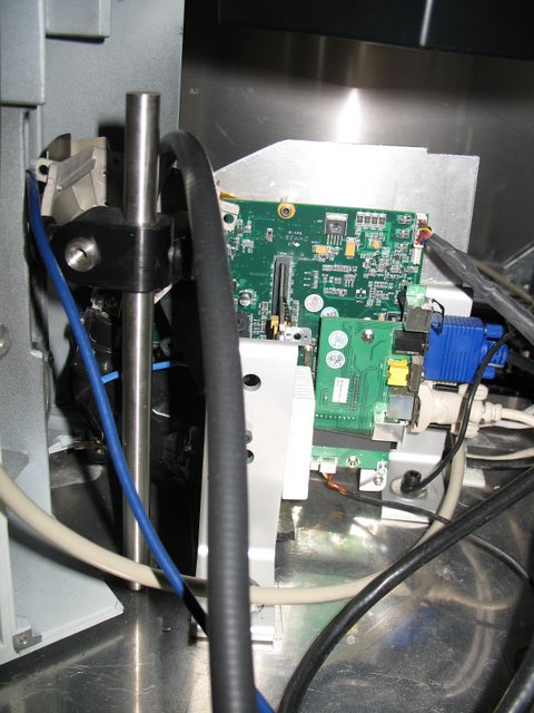 Meister Lab: The same microscope from behind. The trans-illumination lamp has been removed and replaced with a digital projector. This allows patterned images to be presented to the retain while cellular responses are recorded. Incompatible E.M.F. sources have been removed or modified.