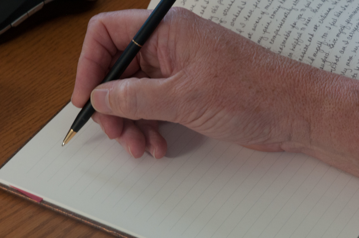 Journal-Keeping-hand-and-pen