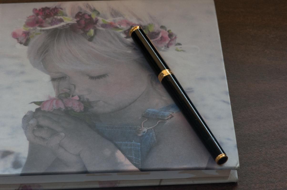 Journal-Keeping-05-Girl-journal-and-pen.jpg