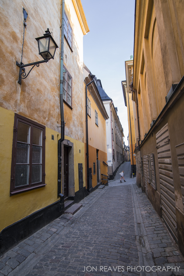 Cobblestones and colorful buildings in Gamla Stan, Stockholm.