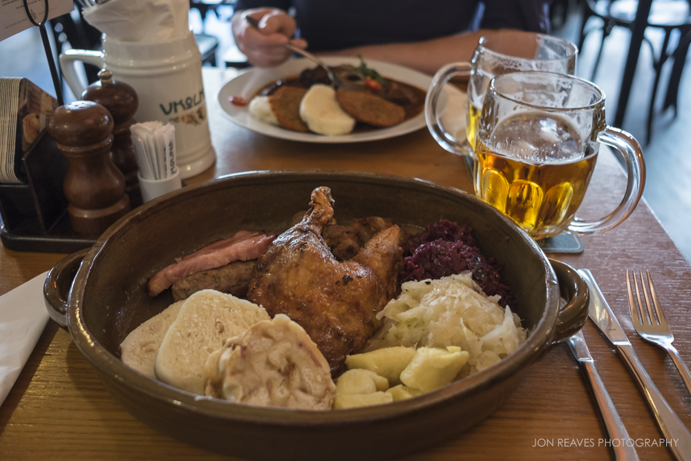 "An authentically meaty Czech meal with duck, ham, sausage, bread dumplings, cabbage, and beer....can you say ""meat sweats?"" Prague, Czech Republic"