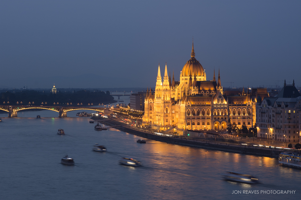 Boats on the Danube and Hungarian Parliament at twilight.