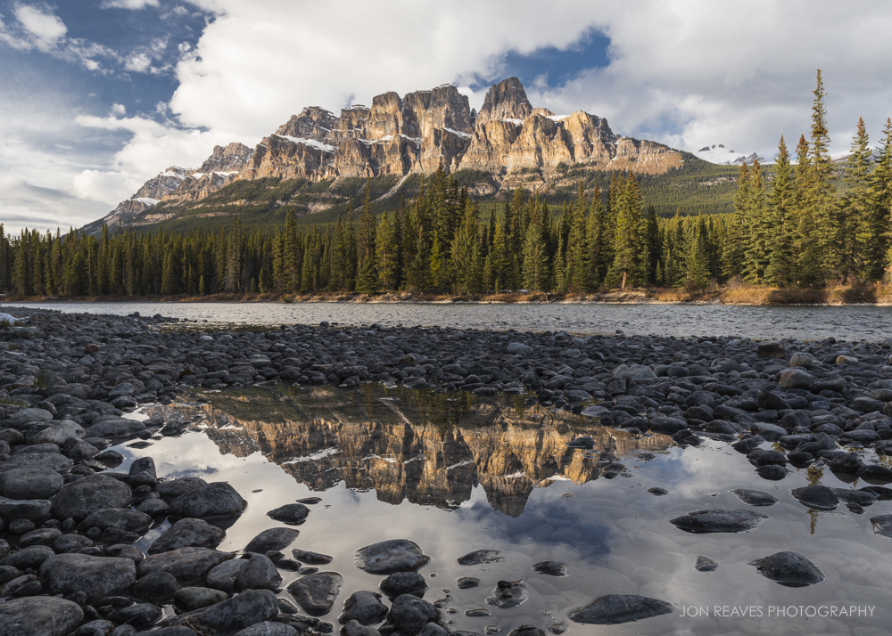 Reflection of the peaks of Castle Mountain in the Bow River