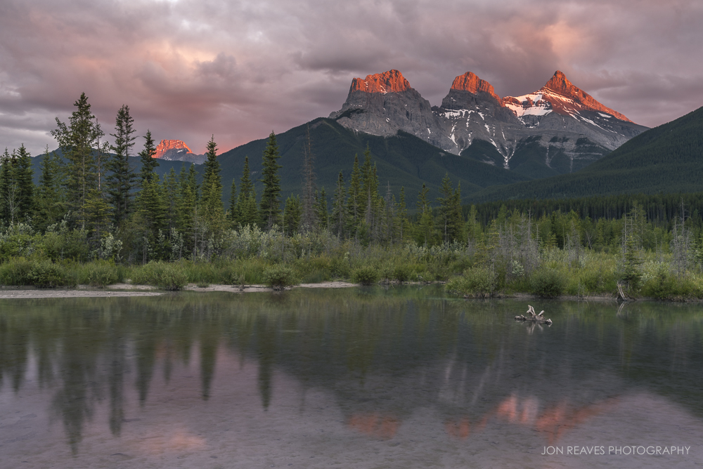 Alpenglow on the peaks of Three Sisters, Canmore, Alberta