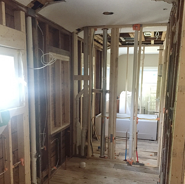 From that one tiny bathroom, we took out a closet and a linen closet to make a kid's bathroom and a master bath.