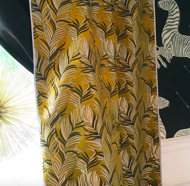 I loved the texture of the metal starburst, chartreuse brocade with metallic print curtains and the wallpaper with metallic finishes in the zebra's stripes