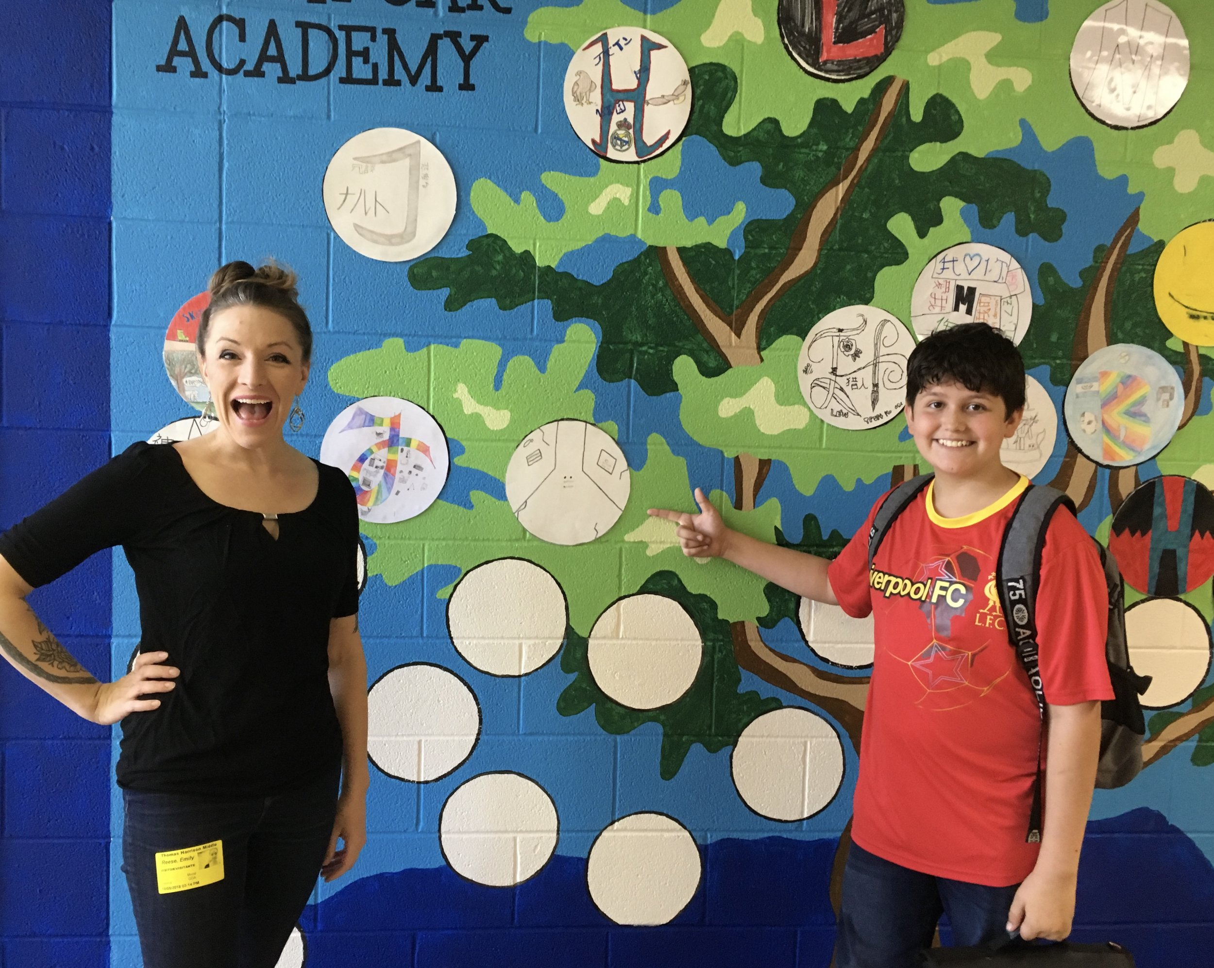Our founder and one of our student participants show off the collaborative mural!