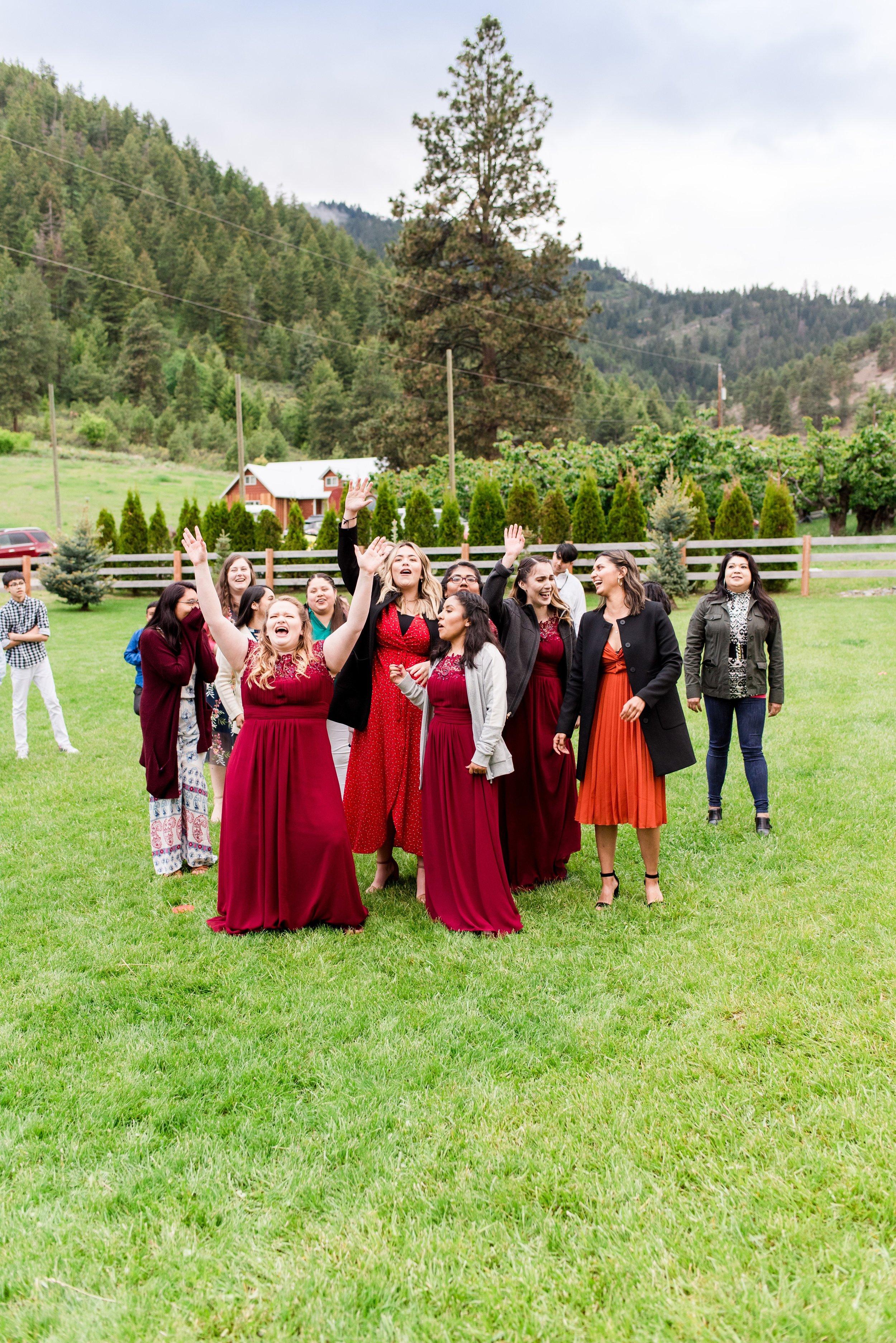 Bouquet Toss - Wenatchee, Washington White Barn Wedding - Hampton Hideaway - Morgan Tayler Photo & Design - Wenatchee Wedding Photographer
