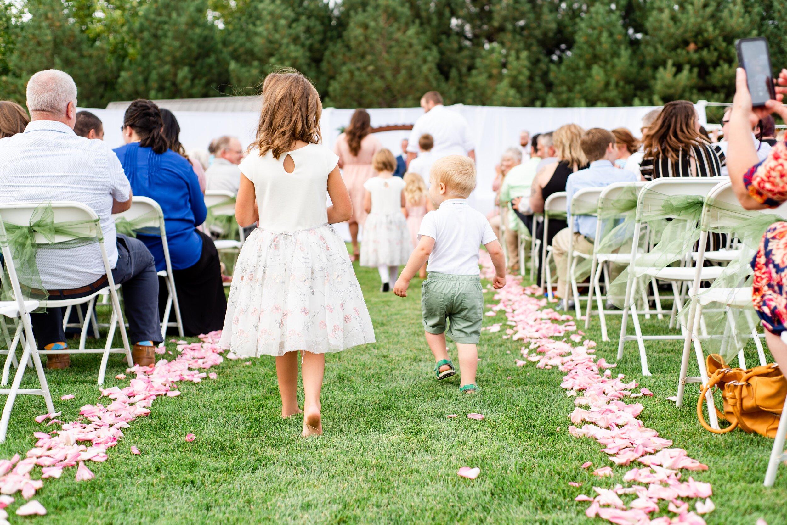 Flower Girl & Ring Bearer Walking Up Aisle - Tri Cities Wedding Photographer - Morgan Tayler Photo & Design - Tri Cities Washington Backyard Wedding